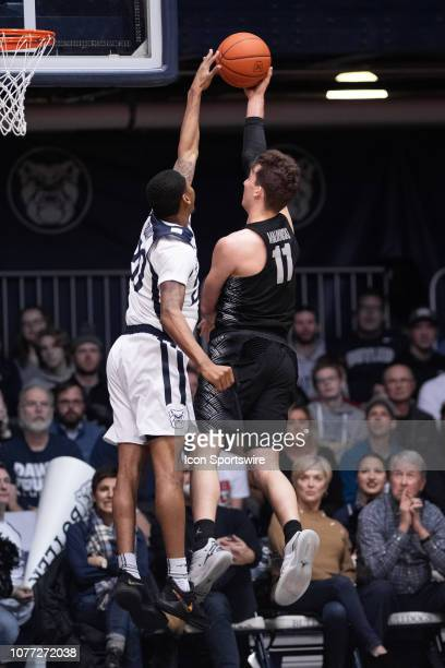 Georgetown Hoyas guard Greg Malinowski drives by Butler Bulldogs guard Henry Baddley during the men's college basketball game between the Butler...
