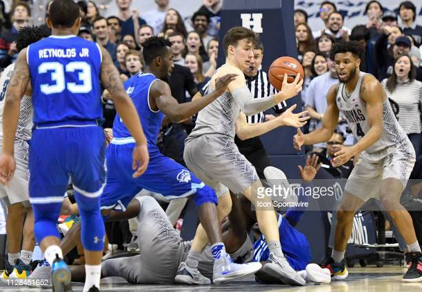 Georgetown Hoyas guard Greg Malinowski fights to control a rebound in overtime against Seton Hall Pirates forward Michael Nzei on March 2 at the...