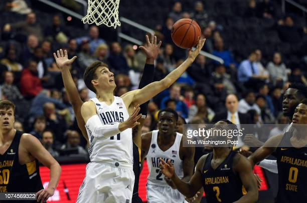WASHINGTON DC DECEMBER Georgetown Hoyas guard Greg Malinowski goes up for two during the second half of the game between the Georgetown Hoyas and the...