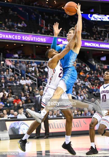 Georgetown Hoyas guard Greg Malinowski is fouled going to the basket in the second half by Howard Bison forward Jalen Jones on December 29 at the...