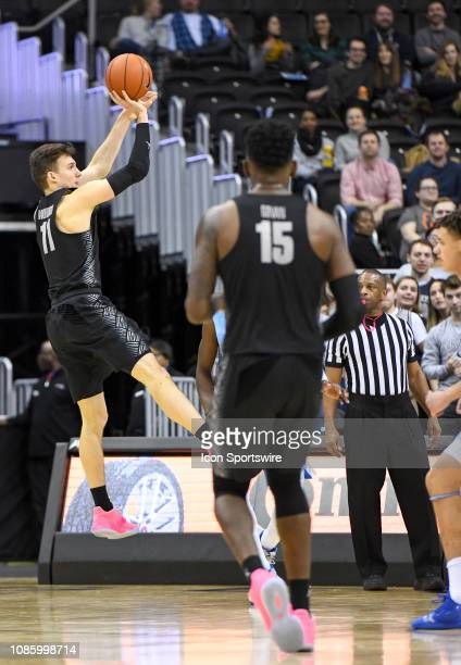 Georgetown Hoyas guard Greg Malinowski makes a three point basket in the first half against the Creighton Bluejays on January 21 at the Capital One...
