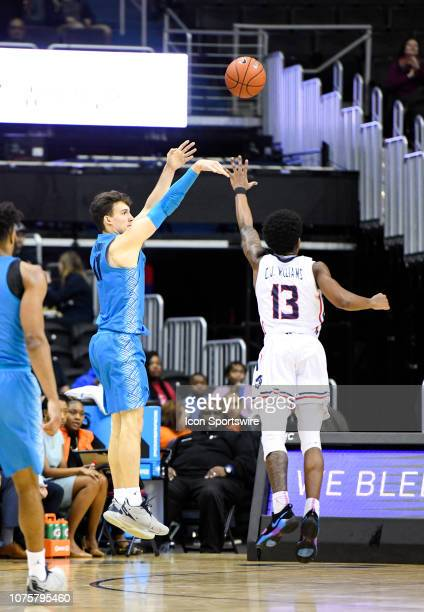 Georgetown Hoyas guard Greg Malinowski makes a three point basket against Howard Bison guard Charles Williams on December 29 at the Capital One Arena...