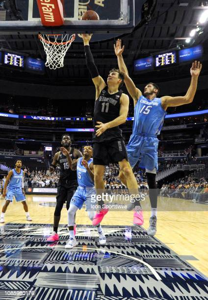 Georgetown Hoyas guard Greg Malinowski scores in the second half against Creighton Bluejays forward Martin Krampelj on January 21 at the Capital One...