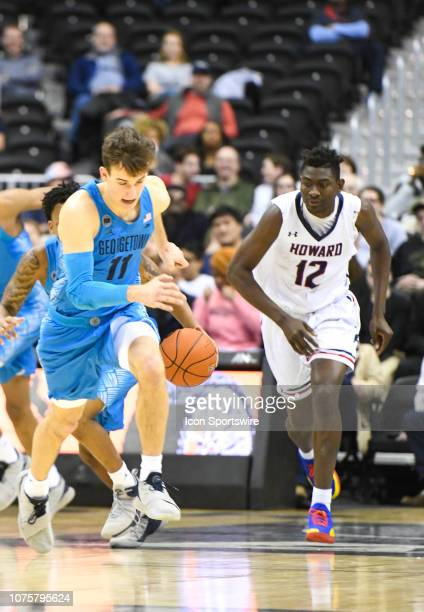 Georgetown Hoyas guard Greg Malinowski steals the ball from Howard Bison center Akuwovo Ogheneyole in the second half on December 29 at the Capital...