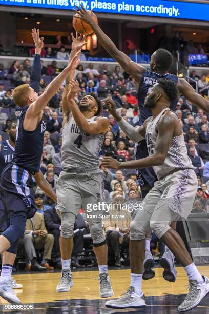 Georgetown Hoyas guard Jagan Mosely has his shot blocked in the second half by Villanova Wildcats forward Dhamir CosbyRoundtree on January 17 at the...