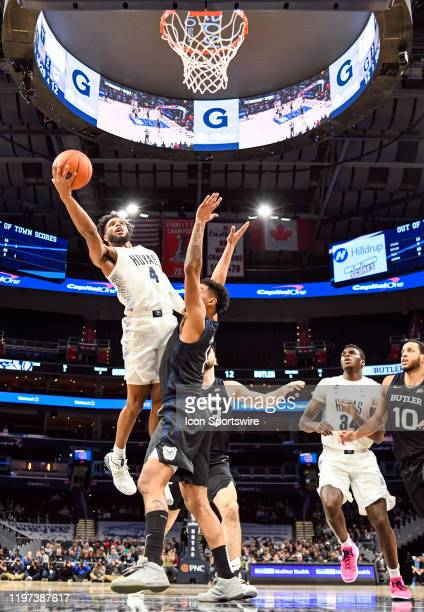 Georgetown Hoyas guard Jagan Mosely scores against Butler Bulldogs forward Jordan Tucker on January 28 at the Capital One Arena in Washington DC