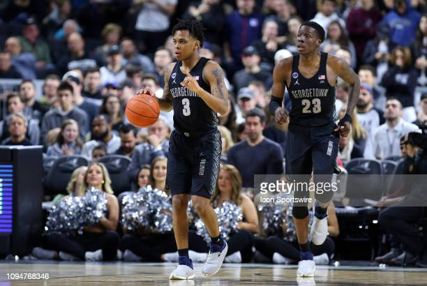 Georgetown Hoyas guard James Akinjo and Georgetown Hoyas forward Josh LeBlanc during a college basketball game between Georgetown Hoyas and...