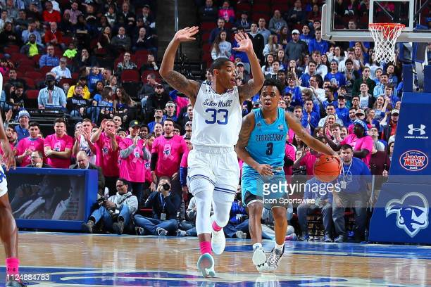 Georgetown Hoyas guard James Akinjo and Seton Hall Pirates guard Shavar Reynolds during the first half of the College Basketball Game between the...
