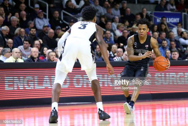 Georgetown Hoyas guard James Akinjo defended by Providence Friars guard David Duke during a college basketball game between Georgetown Hoyas and...