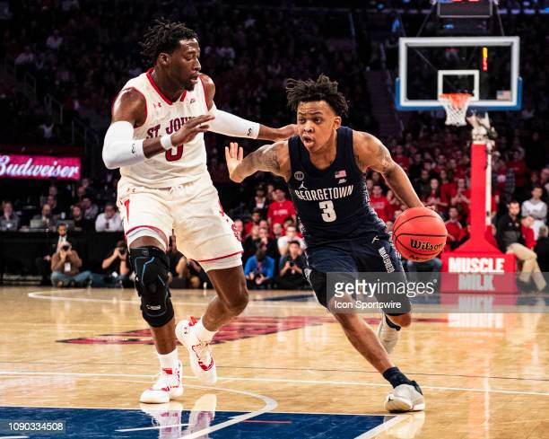 Georgetown Hoyas Guard James Akinjo dribbles the ball against St John's Red Storm Forward Sedee Keita during the second half of the Georgetown Hoyas...