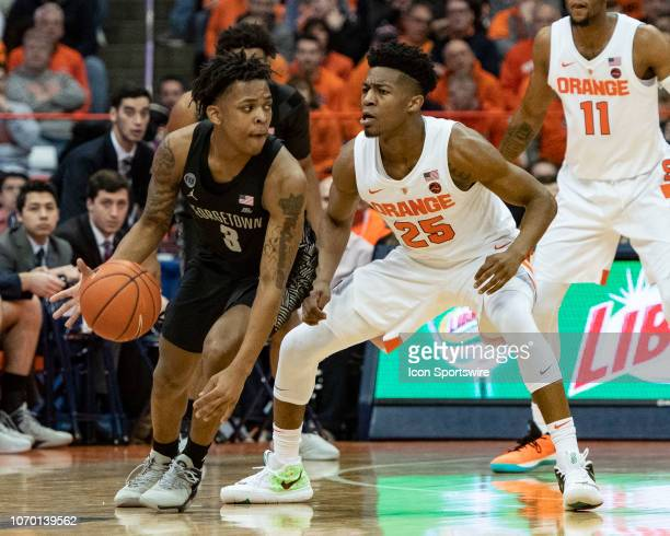 Georgetown Hoyas Guard James Akinjo dribbles the ball around Syracuse Orange Guard Tyus Battle defending during the second half of the Georgetown...