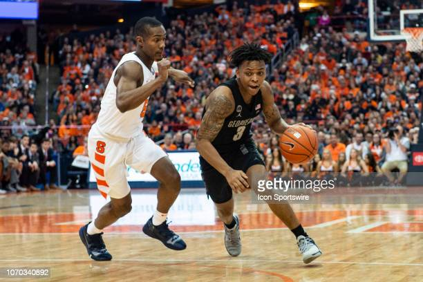 Georgetown Hoyas Guard James Akinjo dribbles the ball past Syracuse Orange Guard Jalen Carey defending during the first half of the Georgetown Hoyas...