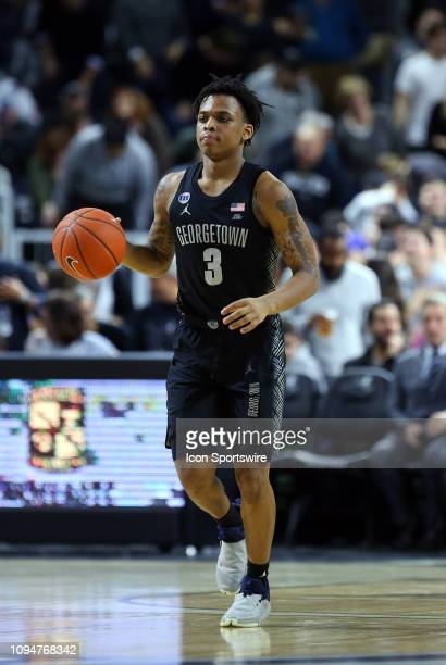 Georgetown Hoyas guard James Akinjo dribbles the ball up court during a college basketball game between Georgetown Hoyas and Providence Friars on...