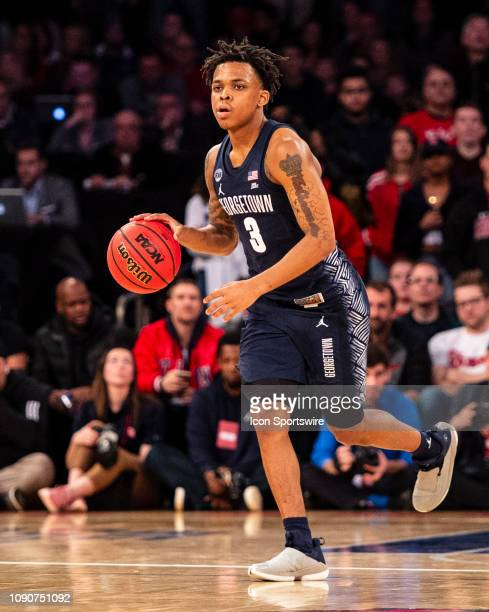 Georgetown Hoyas Guard James Akinjo dribbles the ball up the court during the second half of the Georgetown Hoyas versus the St John's Red Storm game...
