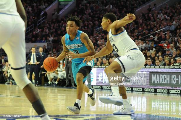 Georgetown Hoyas guard James Akinjo drives the lane against Villanova Wildcats forward Jermaine Samuels during the game between the Georgetown Hoyas...