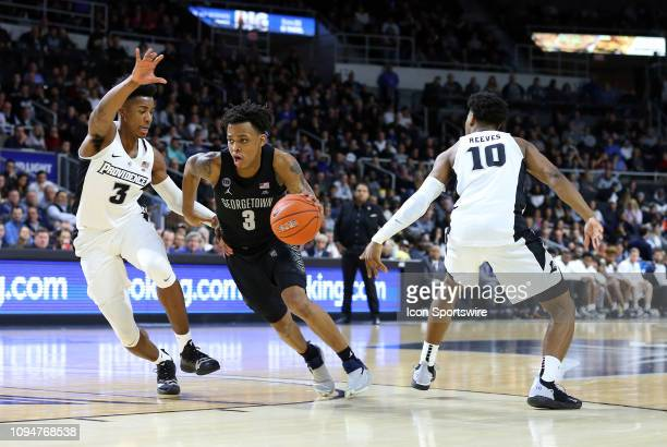 Georgetown Hoyas guard James Akinjo drives to the basket between Providence Friars guard David Duke and Providence Friars guard AJ Reeves during a...
