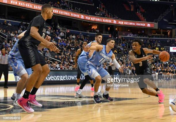 Georgetown Hoyas guard James Akinjo drives to the basket in the second half against Creighton Bluejays guard Marcus Zegarowski on January 21 at the...