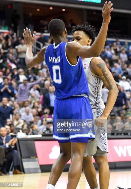 Georgetown Hoyas guard James Akinjo guards Seton Hall Pirates guard Quincy McKnight very closely on March 2 at the Capital One Arena in Washington DC