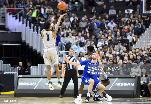 Georgetown Hoyas guard James Akinjo in action against Seton Hall Pirates forward Sandro Mamukelashvili in the first half on March 2 at the Capital...