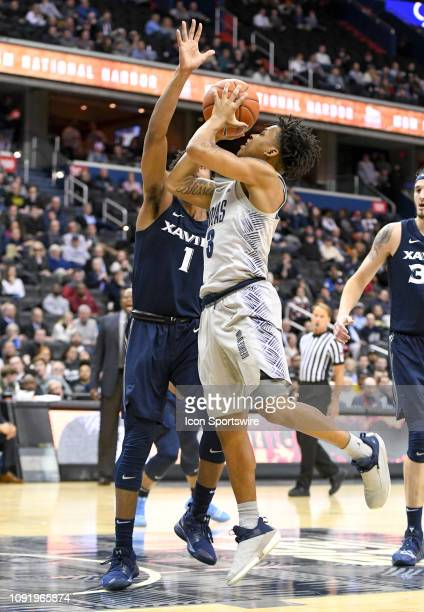 Georgetown Hoyas guard James Akinjo makes a second half shot and is fouled by Xavier Musketeers guard Paul Scruggs on January 31 at the Capital One...