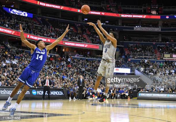 Georgetown Hoyas guard James Akinjo scores against Seton Hall Pirates guard Jared Rhoden on March 2 at the Capital One Arena in Washington DC