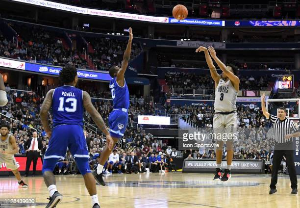 Georgetown Hoyas guard James Akinjo scores on a three point shot over Seton Hall Pirates guard Quincy McKnight on March 2 at the Capital One Arena in...