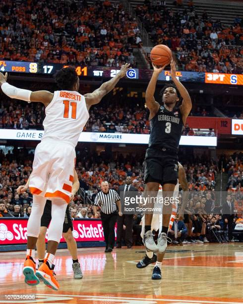 Georgetown Hoyas Guard James Akinjo shoots a jump shot with Syracuse Orange Forward Oshae Brissett defending during the first half of the Georgetown...