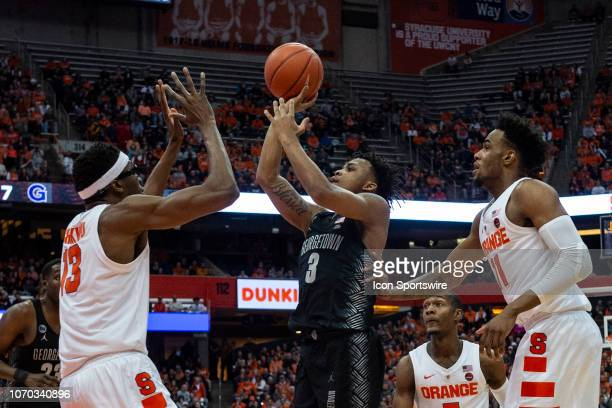 Georgetown Hoyas Guard James Akinjo shoots the ball over Syracuse Orange Center Paschal Chukwu defending during the first half of the Georgetown...