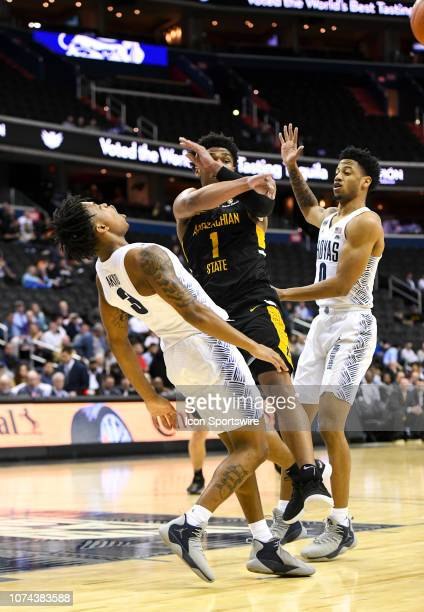 Georgetown Hoyas guard James Akinjo tries to draw a foul on Appalachian State Mountaineers guard Justin Forrest in the first half on December 18 at...