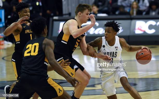 WASHINGTON DC DECEMBER Georgetown Hoyas guard James Akinjo tries to work his way to the basket past the Appalachian State Mountaineers defense during...