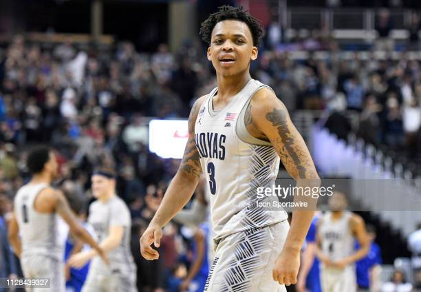Georgetown Hoyas guard James Akinjo walks off the court following the double overtime win against the Seton Hall Pirates on March 2 at the Capital...