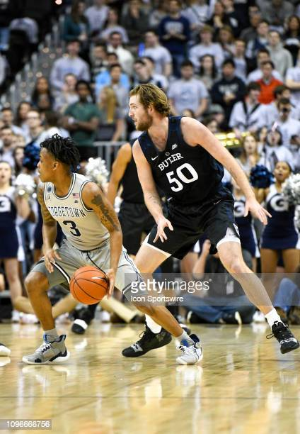 Georgetown Hoyas guard James Akinjo works against Butler Bulldogs forward Joey Brunk in the first half on February 9 at the Capital One Arena in...