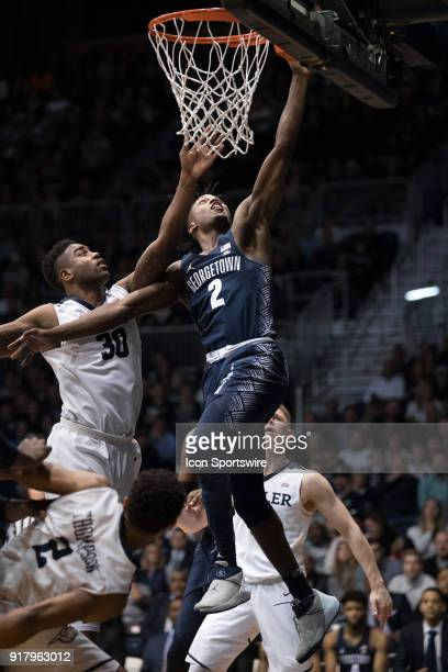 Georgetown Hoyas guard Jonathan Mulmore drives by Butler Bulldogs forward Kelan Martin on a fast break for a layup during the men's college...