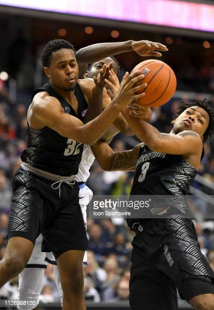 Georgetown Hoyas guard Kaleb Johnson and guard James Akinjo fight for rebound in the first half against the Villanova Wildcats on February 20 at the...
