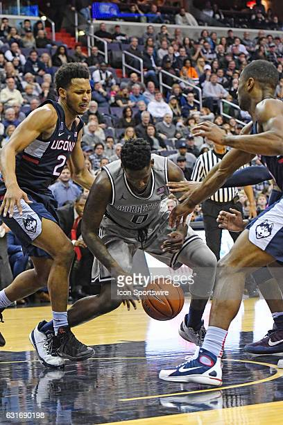 Georgetown Hoyas guard LJ Peak picks up a loose ball and scores in the second half against Connecticut Huskies guard Jalen Adams on January 14 at the...
