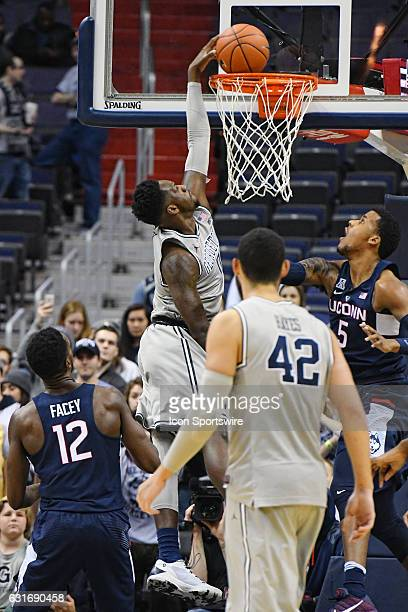 Georgetown Hoyas guard LJ Peak scores in the first half against Connecticut Huskies forward Vance Jackson on January 14 at the Verizon Center in...