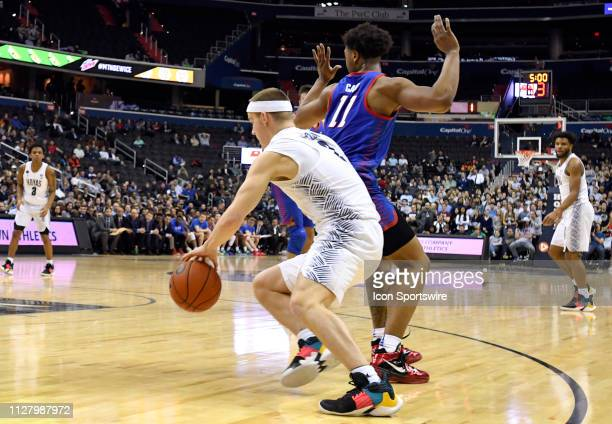 Georgetown Hoyas guard Mac McClung drives and his fouled by DePaul Blue Demons guard Eli Cain in the second half on February 27 at the Capital One...