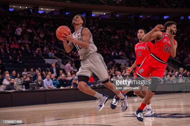 Georgetown Hoyas guard Terrell Allen is fouled during the second half of the Big East tournament first round game between the St. Johns Red Storm and...