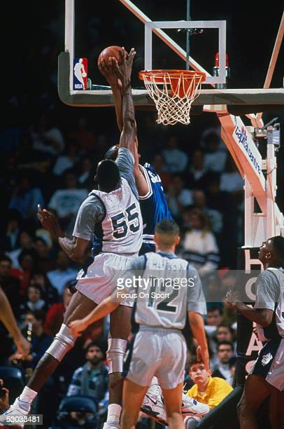 Georgetown Hoyas' Oikembe Mutombo jumps and block a shot during a game