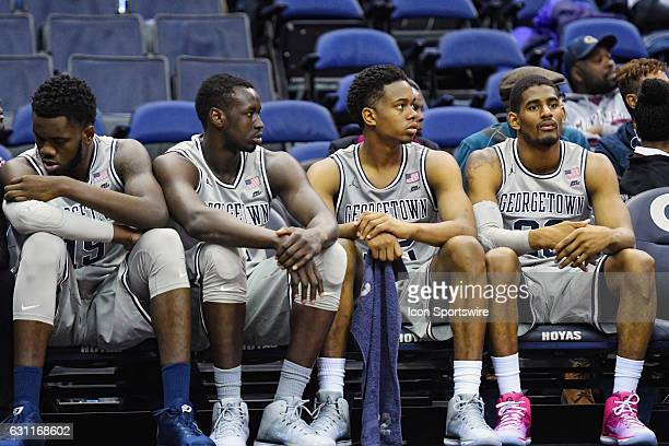 Georgetown Hoyas players sit on the bench as time winds down in overtime against the Butler Bulldogs on January 7 at the Verizon Center in Washington...