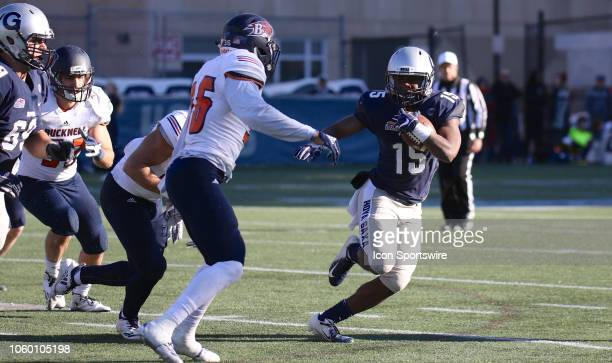 Georgetown Hoyas quarterback Herman Moultrie III advances the ball during the Patriot League college football game between the Georgetown Hoyas and...