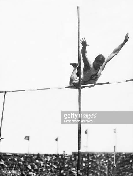 Georgetown University decathlon star Emerson Norton clearing the bar at 11 foot 1 inch in the pole vault at the Penn Relay Carnival held at Franklin...