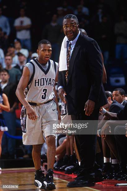 Georgetown University's coach John Thompson sends in replacement Allen Iverson during a game