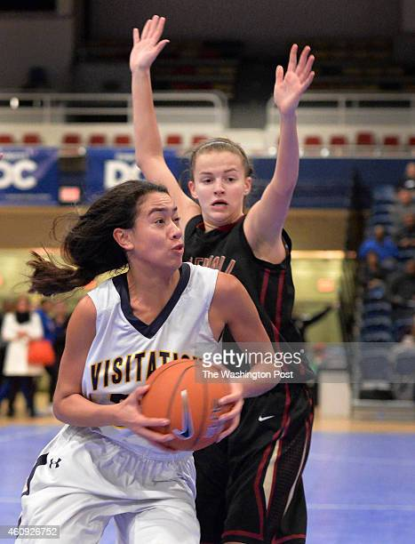 Georgetown Visitation's Maddy Reed goes to the basket pass Stonewall Jackson's Hayley Nordike in the Title IX Holiday Invitational Classic at the DC...