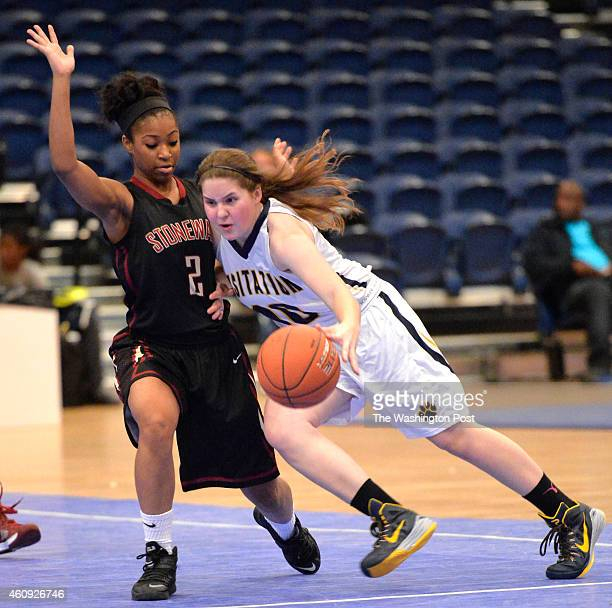 Georgetown Visitation's Sydney Love-Baker looked to get pass Stonewall Jackson's Genesis Parker in the Title IX Holiday Invitational Classic at the...
