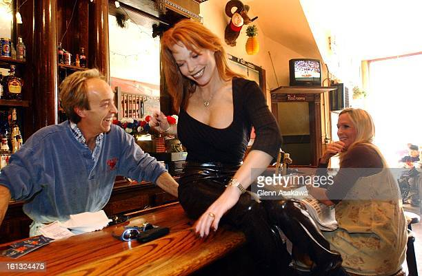 GEORGETOWN111201Georgetown Mayor Koleen Brooks climbs over the bar of the Red Ram Restaurant to greet bartender Mark Wallisa recently The...