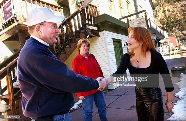 GEORGETOWN111201Georgetown Mayor Koleen Brooks greets tourist Bruce Fitzgerald of Washington Illinois as his wife Linda looks on while the couple...