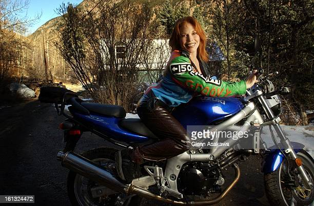 GEORGETOWN111201Georgetown Mayor Koleen Brooks shows off her Suzuki racing motorcyle that she actually competes in races with The controversial Mayor...