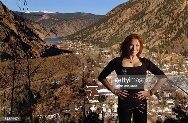 GEORGETOWN111201Georgetown Mayor Koleen Brooks stands at an overlook with a view of Georgetown and the I70 corridor in the background She is sporting...