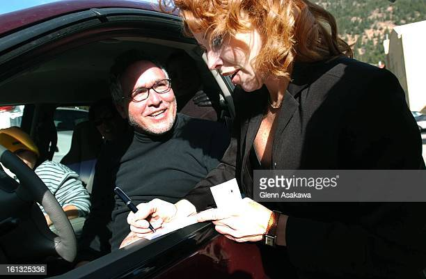 GEORGETOWN4202Georgetown Mayor Koleen Brooks signs an autograph for Ben Aguirre a tourist from Miami who was visiting Georgetown Tuesday He learned...